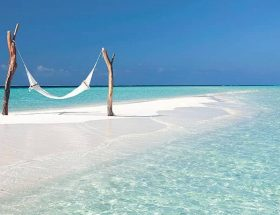 Constance Moofushi with Hammock on Sandbank